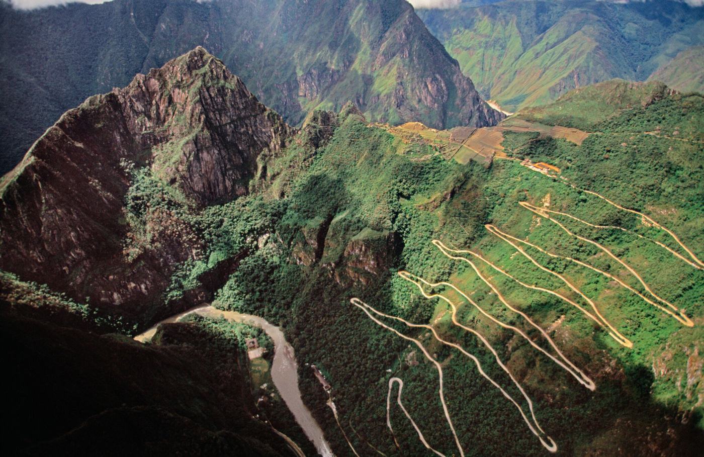 An aerial view of a switchback road leading up to Machu Picchu, Peru.