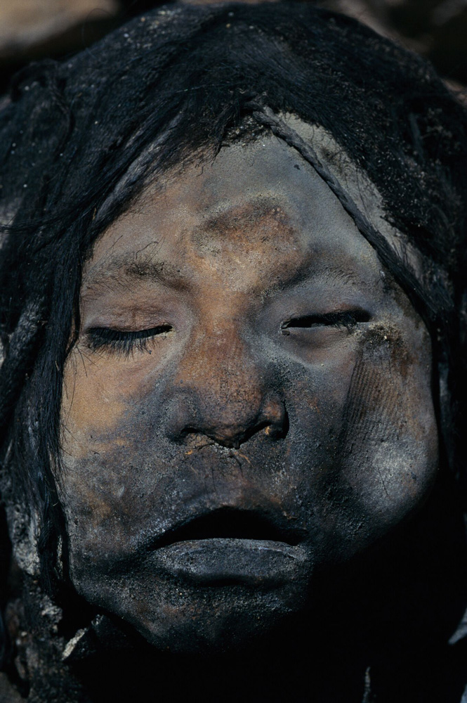 Pictured is the mummified face of a girl sacrificed by Inca priests 500 years ago. Llullaillaco Maiden and her fellow mummified counterparts, found in 1999, were discovered in a remarkable state of natural preservation due to the frigid conditions just below the mountain's 22,110-foot (6,739-meter) summit.