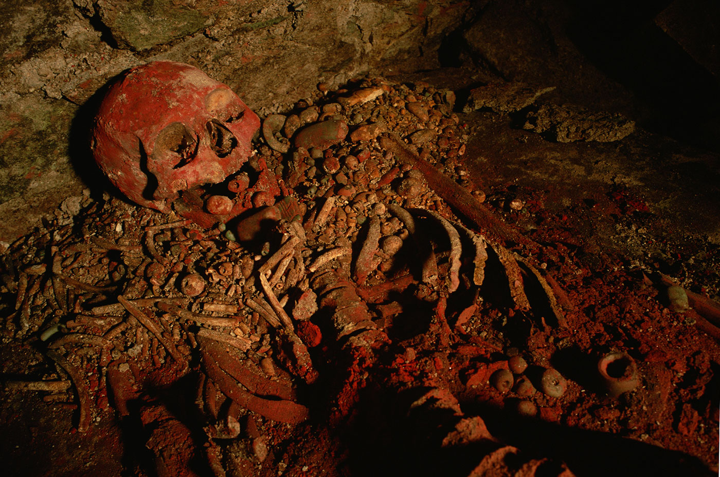 Mercury, a toxic heavy metal used to extract silver and gold from ore in a process called amalgamation, comes from the mineral cinnabar, which is crushed to make vermilion pigment. The remains pictured above are covered in cinnabar, which may have been used for ceremonial or decorative purposes.