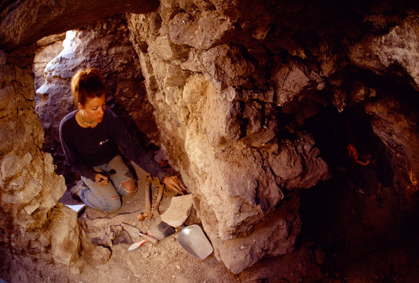 A team member works at excavating a Wari site in Conchopata, Peru.