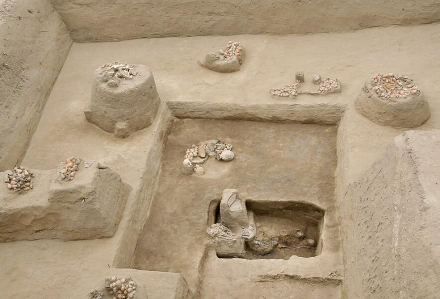 Ceramic vessels and other offerings surround the grave of the elite 14th-century executioner.