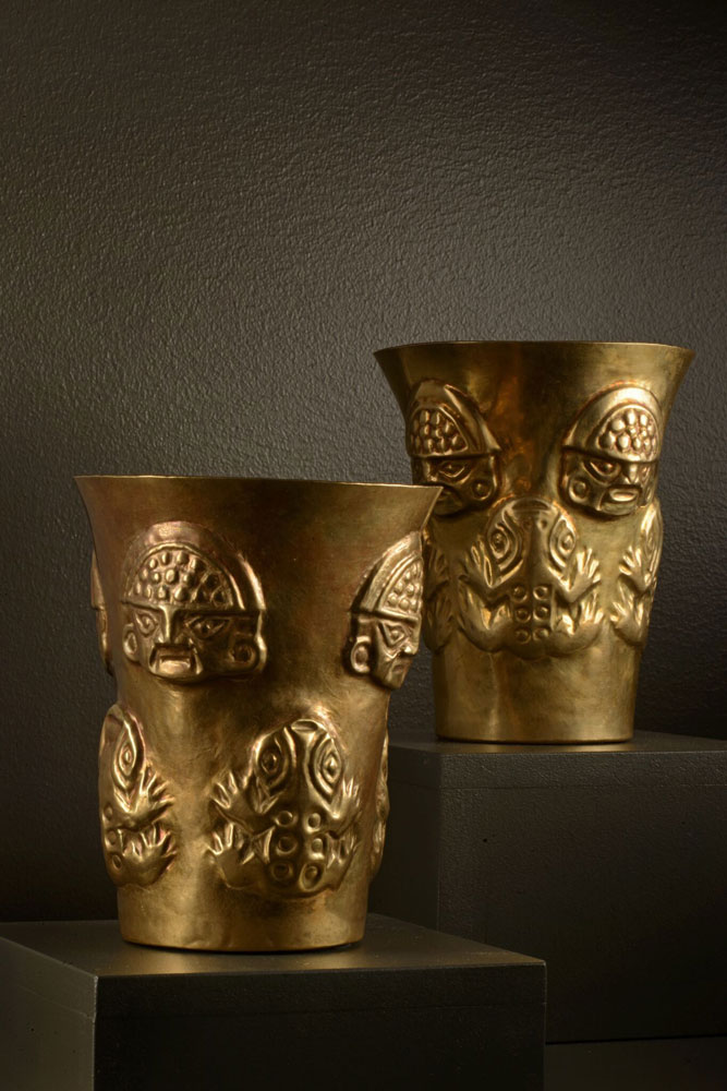 A matched pair of Sicán ceremonial cups.